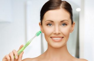 bright picture of beautiful woman with toothbrush